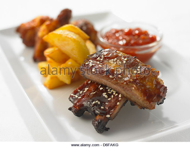 Pork Ribs with sweet Chilli Source and Chips - Stock Image