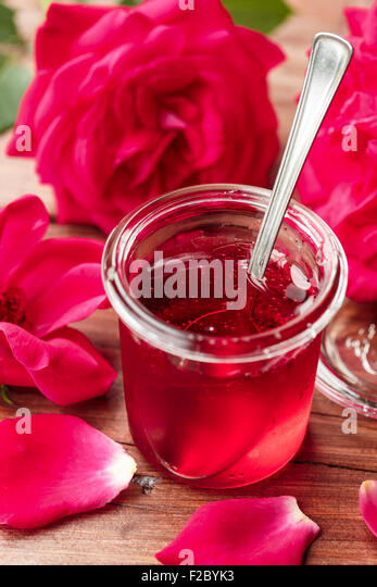 Jar of rose jelly - Stock Image
