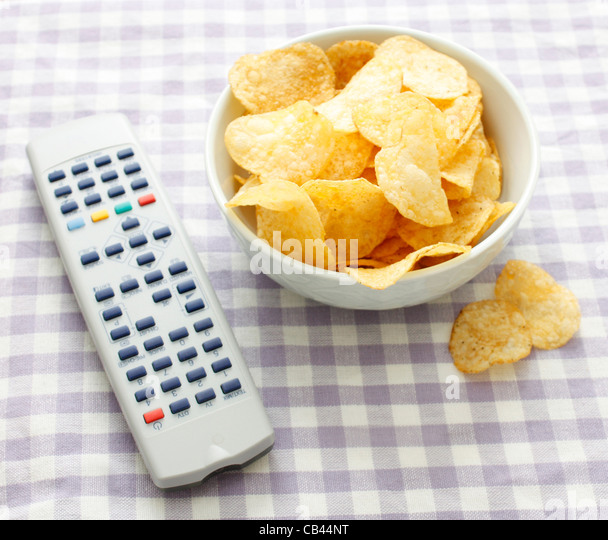 Chips and remote - Stock-Bilder