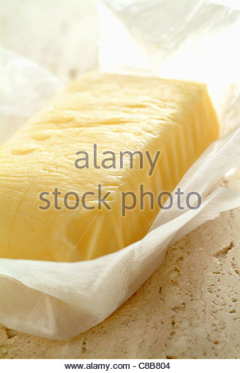 slab of butter in paper - Stock Image