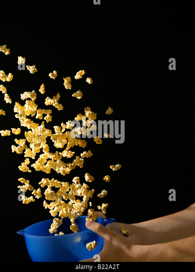 Popcorn Flying out of Bowl - Stock Image
