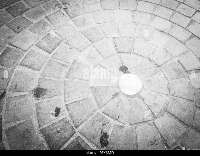 cobblestones in circle. Image of urban pavement dirty - Stock Image