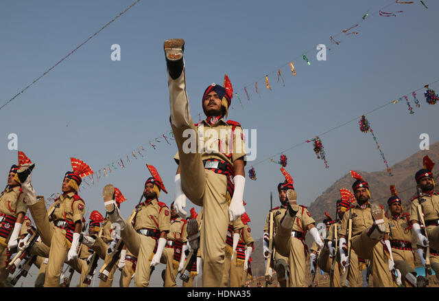 Srinagar, Kashmir. 14th Dec, 2016. Recruits of Indian police march during a passing out parade at a training center - Stock Image