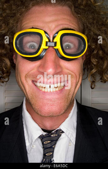 crazy,grimace,swimming goggles - Stock Image
