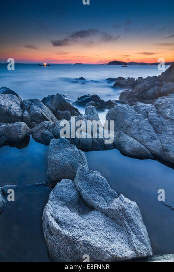 Japan, Aichi Prefecture, Beach with boats in distance - Stock Image