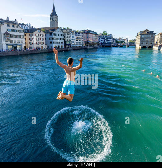 Man jumping into River Limmat, Zurich, Switzerland - Stock Image