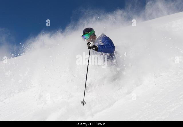 Freeride skiing in deep powder - Stock Image