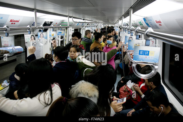 crowded subway car stock photos crowded subway car stock images alamy. Black Bedroom Furniture Sets. Home Design Ideas