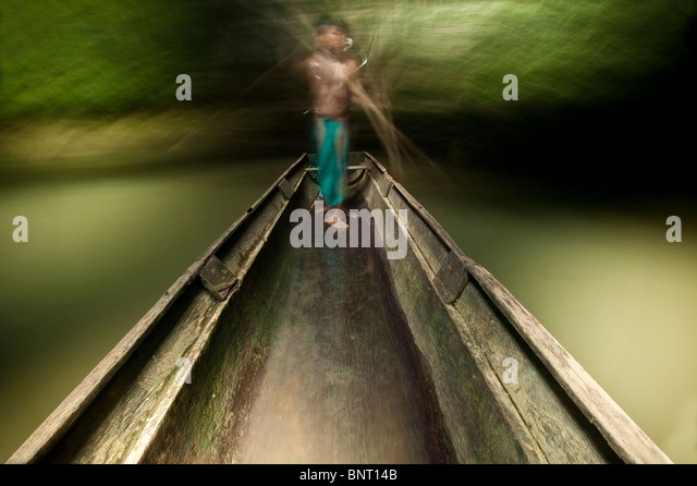 Embera indian man in his boat on Mogue river in the Darien province, Republic of Panama. - Stock-Bilder