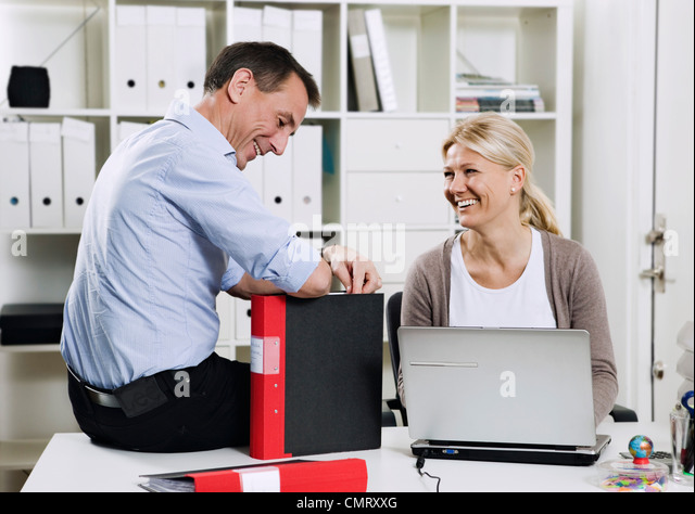Two people at the office - Stock Image