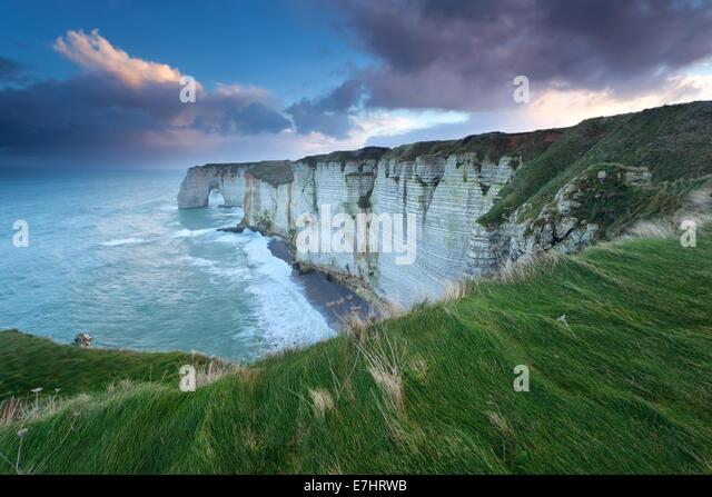 sunrise over Atlantic ocean rocky coast, Etretat, Normandy, France - Stock Image
