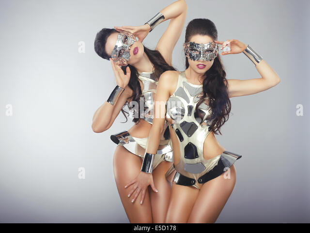 Vogue. People in Sparkling Cosmic Cyber Costumes Gesturing - Stock Image