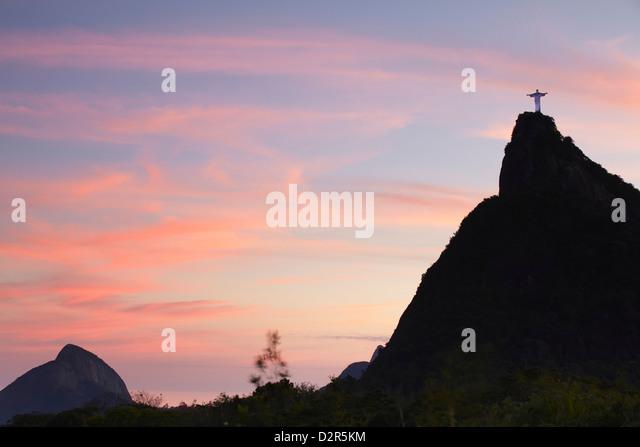 Christ the Redeemer statue (Cristo Redentor) at sunset, Corvocado, Rio de Janeiro, Brazil, South America - Stock Image