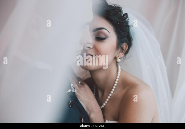 Bride and groom in a hotel room - Stock-Bilder