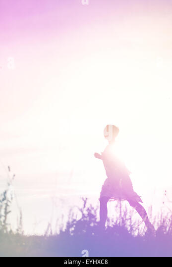 Woman Running to Freedom Through Countryside Field, Escape, Breakout Concept, Silhouette of Female Person, Double - Stock-Bilder