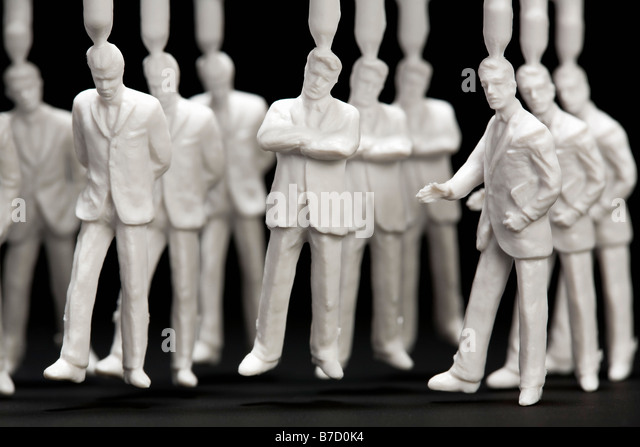 A medium group of plastic businessmen figurines - Stock Image