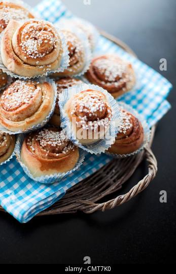 A pile of cinnamon buns - Stock Image