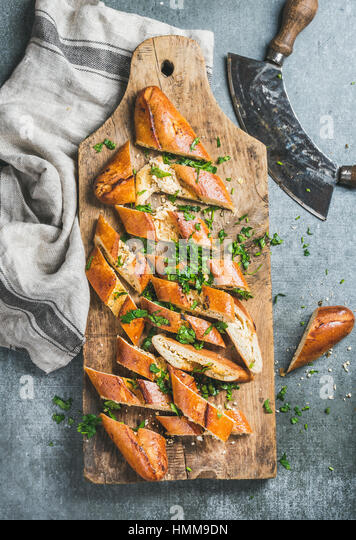 Turkish pizza pide with cheese and spinach chopped in slices - Stock Image