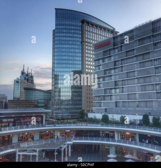 View of Lazona shopping mall in foreground with NTT Docomo tower, Muza Kawasaki symphony hall and central tower, - Stock Image