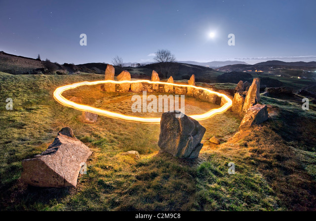 Ring of Fire around Ballymacdermot Court Tomb, Count Armagh. Northern Ireland. - Stock Image
