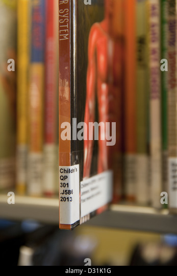 Selective focus showing a Library of Congress System call# label on a spine of a book - Stock-Bilder