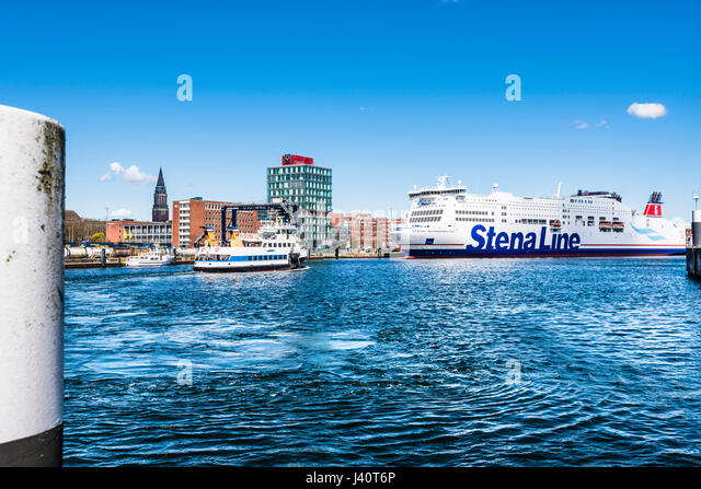 The ferry to Sweden and the passenger ferry on the Kieler Förde in the harbour with the city hall tower, Kiel, - Stock Image