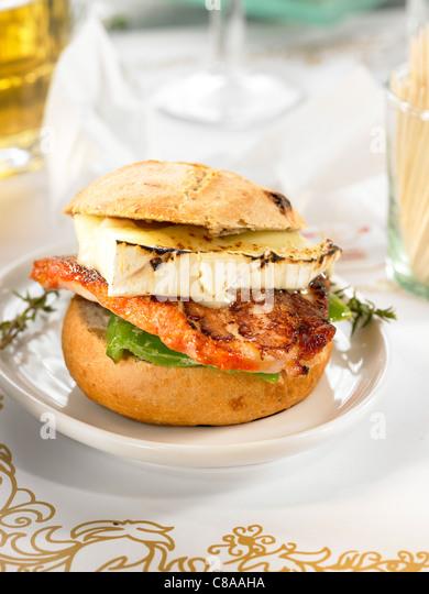 Pork backbone and Brie open sandwich - Stock Image