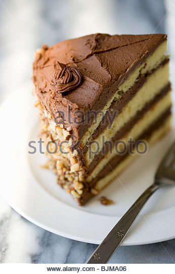 Yellow Layer Cake with Chocolate Frosting - Stock Image