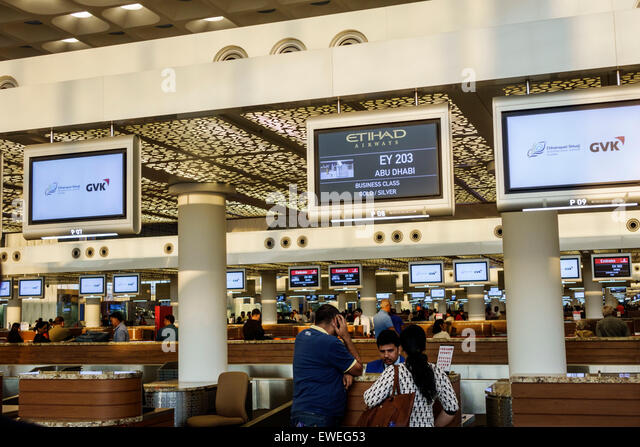 India Indian Asian Mumbai Chhatrapati Shivaji International Airport terminal check in counter Etihad Airways - Stock Image