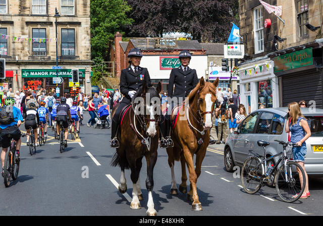 Mounted police in the centre of the West Yorkshire town of Holmfirth on the day of Stage 2 of the 2014 Tour de France, - Stock Image