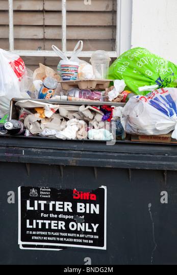 Litter bin overflowing; St Ives; Cornwall - Stock Image