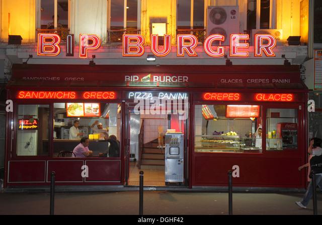 Paris France Europe French 18th arrondissement Montmatre Rue de Steinkerque night nightlife Bip Burger restaurant - Stock Image