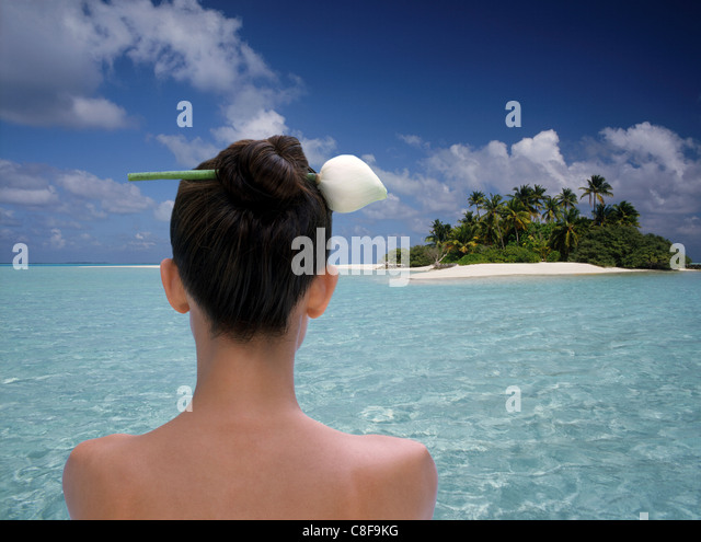 Woman at the atoll of Rhiveli, Maldives, Indian Ocean - Stock Image