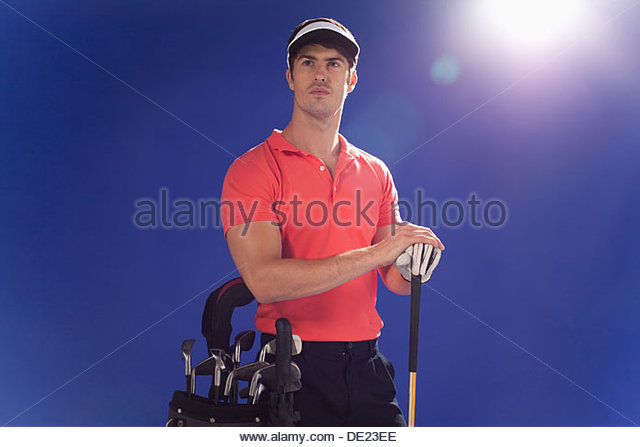 Golf player with club and golf bag - Stock Image