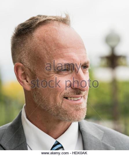 Portrait of smiling Caucasian businessman - Stock Image