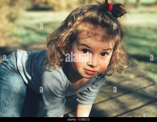 2 year old girl portrait in the forest - Stock Image