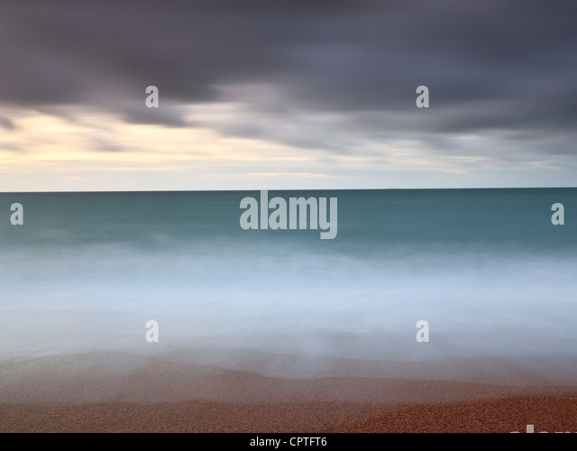 Minimalist seascape at dawn - Stock Image