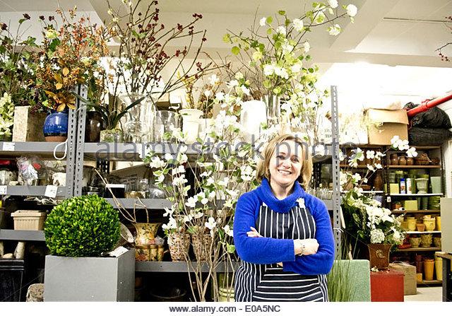 Portrait of floral designer in her studio - Stock Image