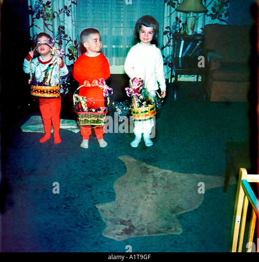 1950's Family Retro Photo,  Children Holding Easter Baskets at Home in Living Room, Vintage - Stock Image