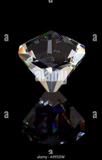 Crystal Diamond relfected on a black background - Stock-Bilder
