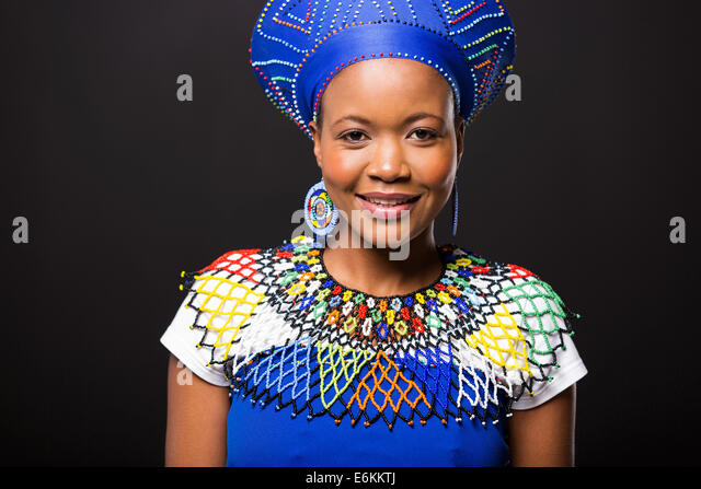 beautiful African woman in traditional clothes portrait on black background - Stock Image