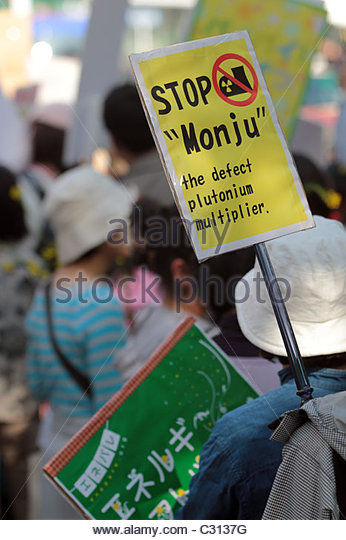 An activist carries a 'stop monju' banner, referring to the Monju plutonium fast-breeder reactor. - Stock Image