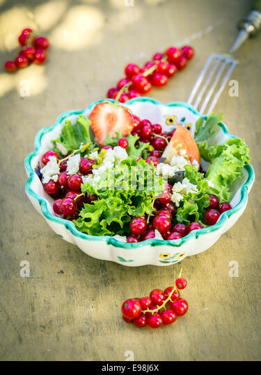 Appetizing Fresh Summer Salad in Bowl on Wooden Background. Good for Vegetarians. - Stock-Bilder