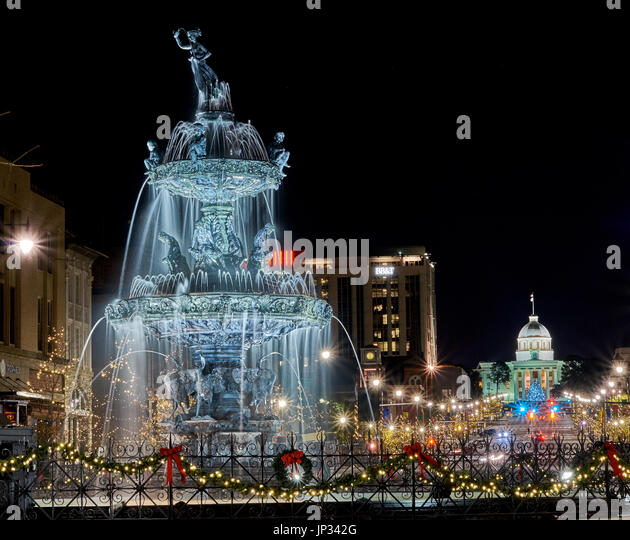 Court Square Fountain in downtown Montgomery, AL is decorated for the Christmas season with the Alabama state capital - Stock Image