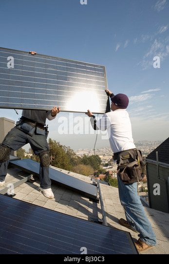 Residential installation of solar panels - Stock Image