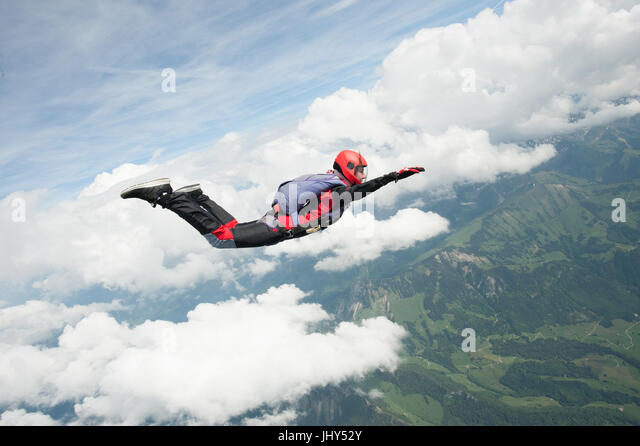 Student skydiver doing a practice jump above Gruyere in Switzerland - Stock Image