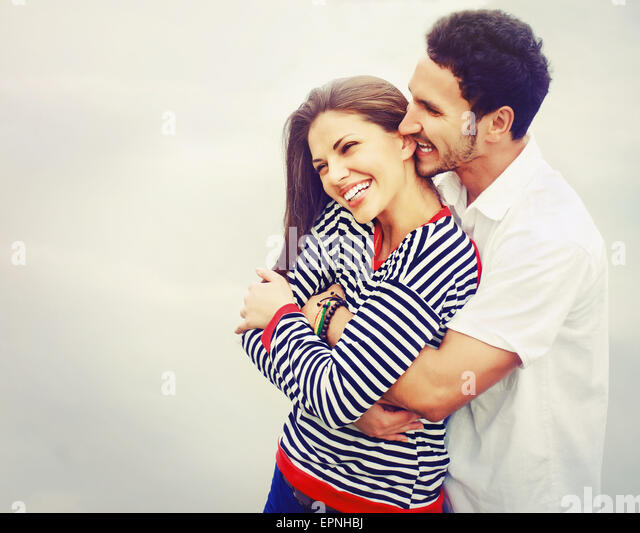 happy romantic wide smile couple in love at the lake outdoor on vacation, beauty of nature, harmony concept - Stock-Bilder
