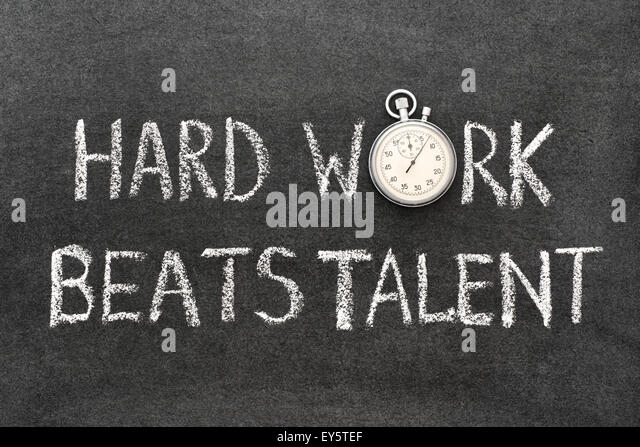 hard work beats talent phrase handwritten on chalkboard with vintage precise stopwatch used instead of O - Stock Image