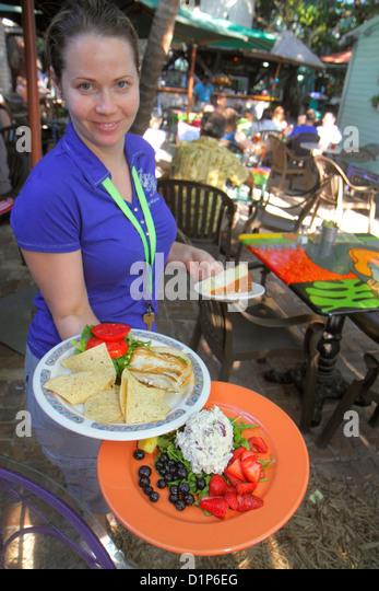 Florida Key West Florida Keys Bahamas Village Petronia Street Blue Heaven restaurant alfresco dining woman waitress - Stock Image
