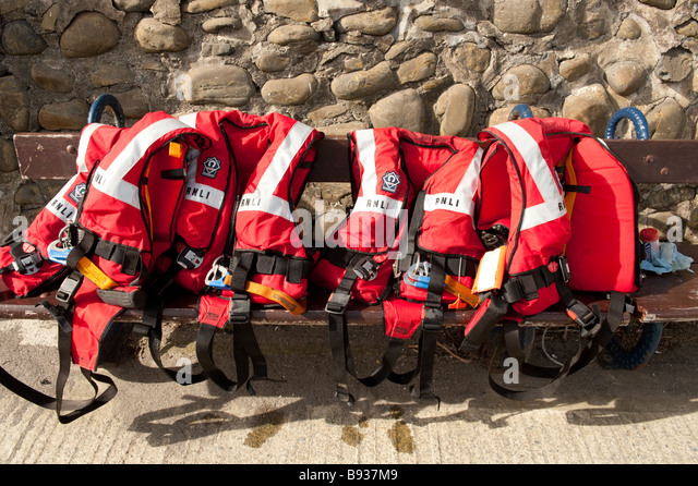 RNLI red safety life jackets, UK - Stock Image